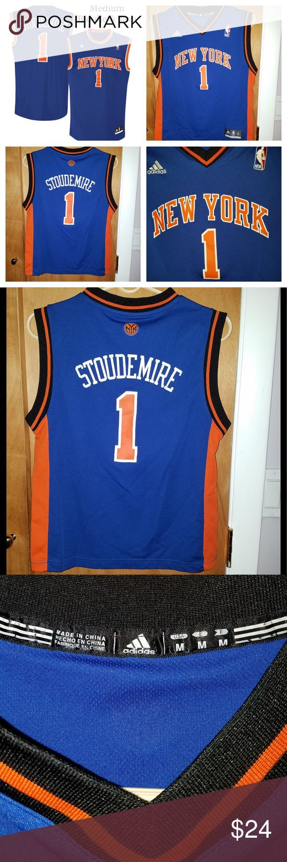 NY Knicks Jersey (Stoudemire) Material: 100% Polyester Dazzle and mesh jersey Screen print name, numbers and logos Embroidered NBA & adidas logos Rib-knit collar and arm holes Back neck taping – no irritating stitch on the back neck Jock tag Machine wash adidas Shirts & Tops