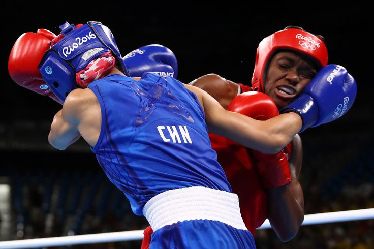 Nicola Adams (R) of Great Britain fights against Cancan Ren of China during a Women's Fly (48-51kg) Semifinal bout on Day 13 of the 2016 Rio Olympic Games at Riocentro - Pavilion 6 on August 18, 2016 in Rio de Janeiro, Brazil.