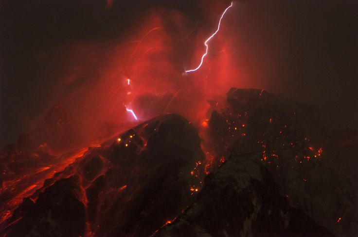KARO, INDONESIA, OCTOBER 14, 2017: Sinabung volcano spews molten lava with lightening storm during eruption in high alert status from Karo, North Sumatra province, Indonesia on October 14, 2017. PHOTOGRAPH BY Sutanta Aditya / Barcroft Images (Photo credit should read Sutanta Aditya / Barcroft Images / Barcroft Media via Getty Images)