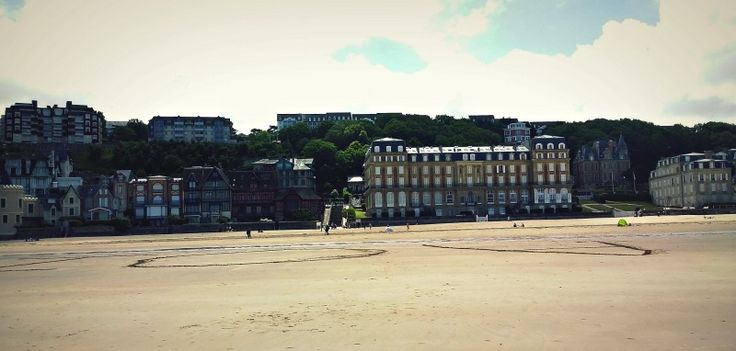 Architecture is in full view on the beach of Trouville, France