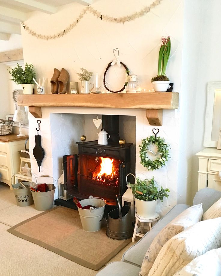 The beautifully accessorised fireplace at Bobbin Cottage.