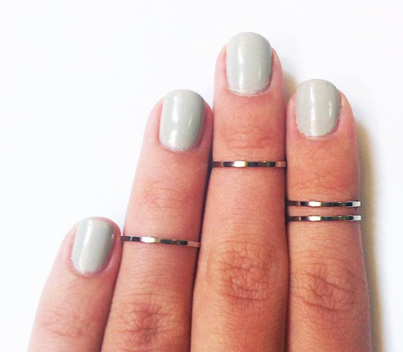 thin silver knuckle rings.