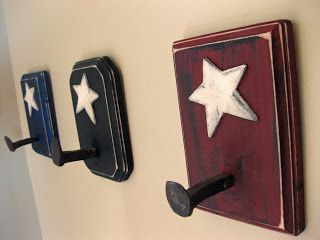 small railroad nails  I hoped to find a 4th and use them in my bathroom as towel hooks but could not find another. I checked a couple of army surplus stores and still came up short, so on to plan B.I picked up some square blocks and stars from Michaels.Painted them, sanded the edges, and added the stars. I used black paint to dry brush the sides for an aged look.