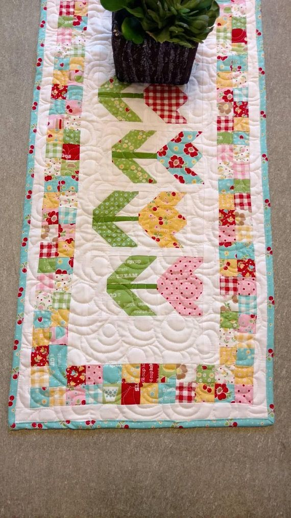 Spring tulip table runner available today, Easter and Mother's Day decor https://www.etsy.com/listing/592289975/spring-quilted-table-runner-tulips