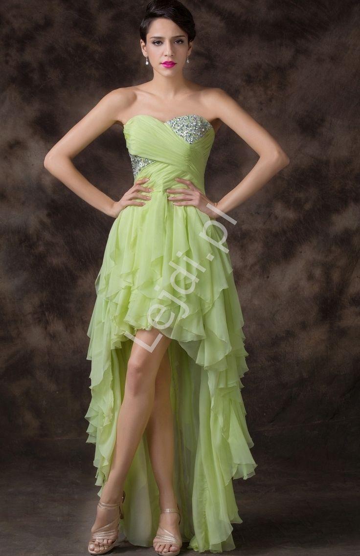 Wieczorowa sukienka z falbanami z drapowanym gorsetem. Część gorsetu wysadzana kryształkami. Z tyłu efektowny zwoewny tren. Sukienka jest opalana na końcówkach falban dzięki czemu falbany sa lekkie i zwiewne. Biust usztywniany gąbkowymi wkładami. Z tyłu gorset umozliwiający dopasowanie sukienki do ciała. Sukienka wykonana z szyfonu. Przepiekny oliwkowo zielony kolor.
