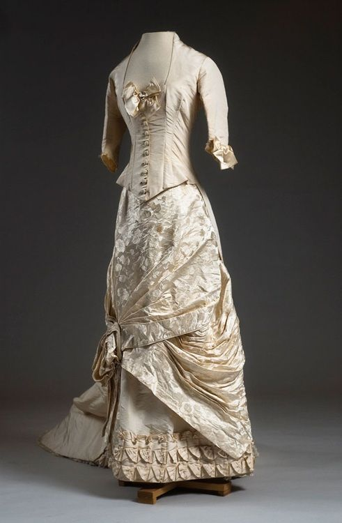 Silk and damask dress, circa 1884. The donor's mother wore this Paris-made dress for her wedding.  Courtesy of the Charleston Museum.
