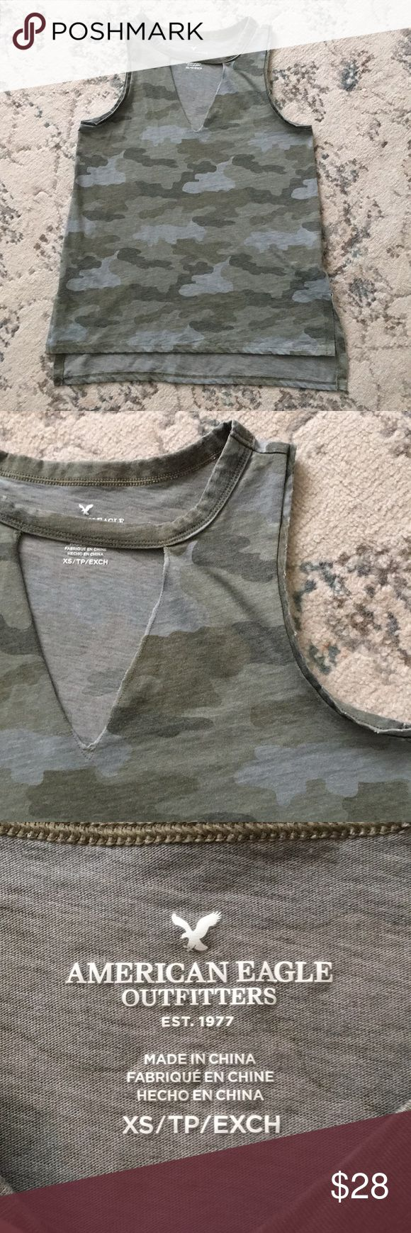 American Eagle Camo Tank American Eagle Camo cut out tank! Size extra small- this tank top has a cut out v neck neckline- distressing along the collar and sleeves- and an on trend Camo print! In excellent condition! Sold out in stores and online! American Eagle Outfitters Tops Tank Tops