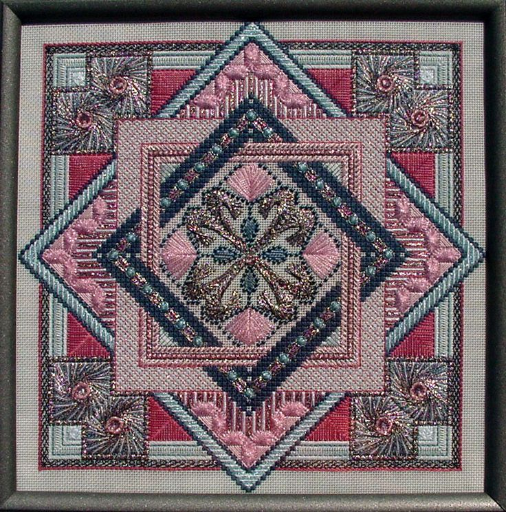 Image from http://www.aznetwork.com/home/crossstitch/images/Mystique.jpg.