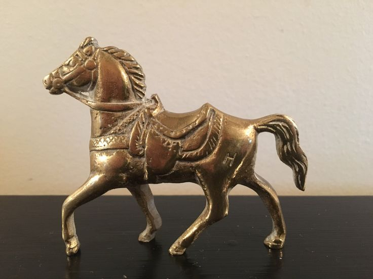 A personal favorite from my Etsy shop https://www.etsy.com/listing/463059170/vintage-solid-brass-horse-with-h-stamp