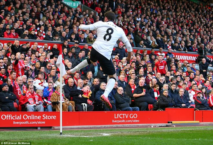 Juan Mata kicks a corner flag after putting his side in the lead during the first half of the Barclays Premier League encounter at Anfield