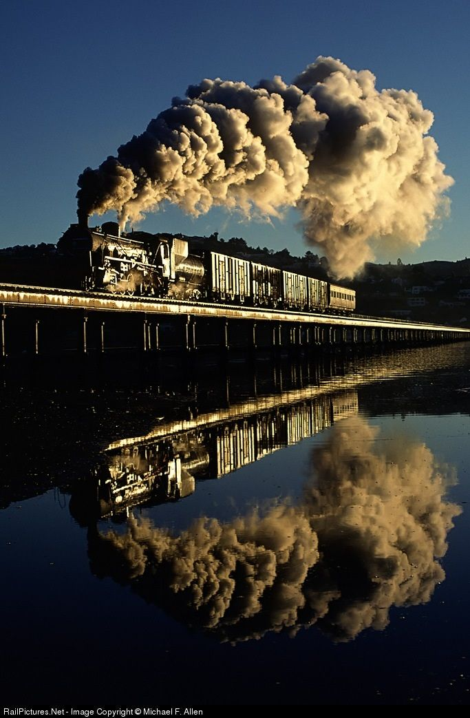RailPictures.Net Photo: 3683 South African Railways Steam 2-8-4 at Knysna, South Africa by Michael F. Allen.   It's early morning as SAR 24 class 2-8-4 takes a Knysna to George mixed train across the Lagoon trestle. Steam Locomotive. Паровоз.