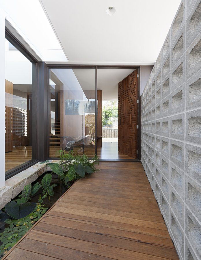 The entryway, door and wall are art! Flipped House by MCK Architects