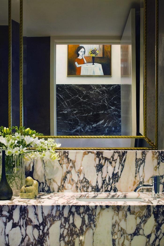 by David Hicks featuring a dark-veined marble sink.
