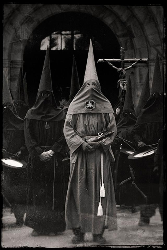 procession. unidentified Semana Santa participant in Spain. Easter.