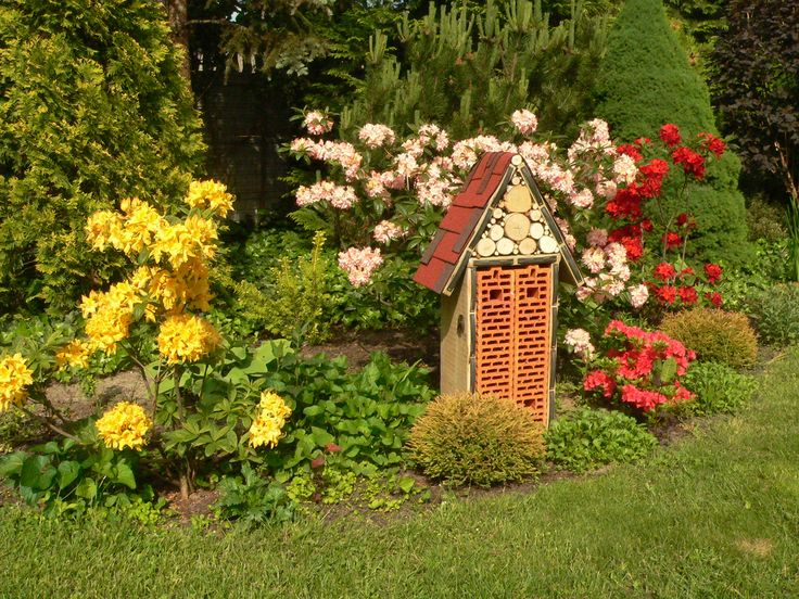 Insect house made of bricks, boards, birch wood and shingles
