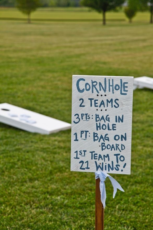 corn hole sign, good idea      We can set up games for outside after the ceremony while the wedding party is getting pictures taken. this would be easy and fun!