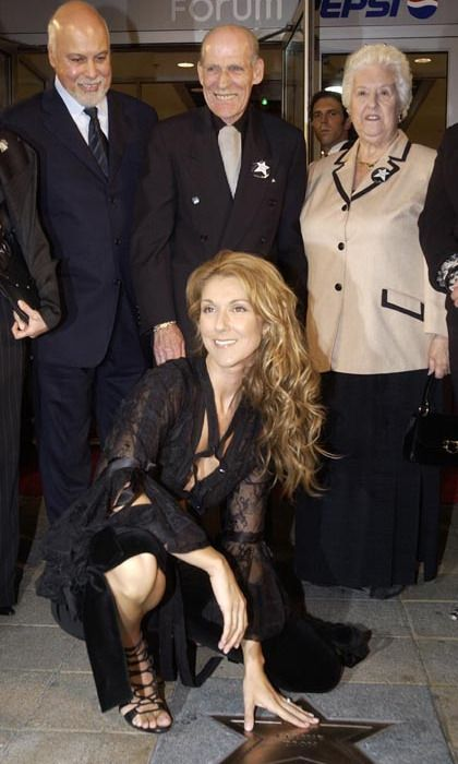 Surrounded by her husband René and her proud parents, Adhemar and Therese, Celine Dion unveiled her Bronze Star in Montreal in 2002.