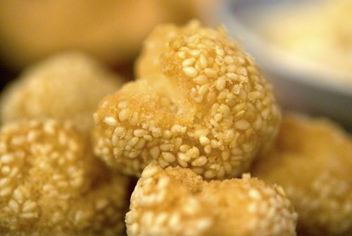 Laughing sesame ball cookies - Chinese New Year snack foods demystified.  This is the only recipe I could find close enough to the yummy ones that I get at Red City (w/o the bean paste stuff...)