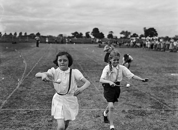 Harlescott [Junior] School Sports. Source: LlGC ~ NLW (Llyfrgell Genedlaethol Cymru/National Library of Wales) on Flickr.  Geoff Charles, 1952. My own claim to fame the only sporting event I ever won was the egg & spoon race when I was in the Brownies!