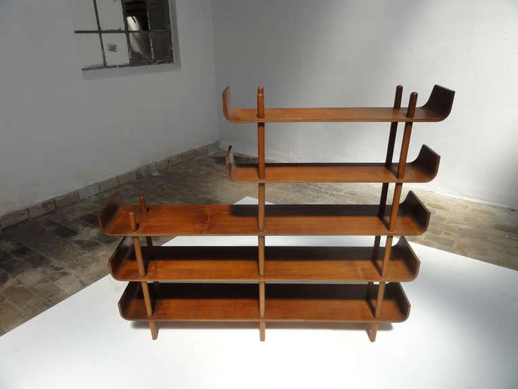 Rare teak plywood shelving by Wilhelm Lutjens for De Boer Gouda | From a unique collection of antique and modern shelves at https://www.1stdibs.com/furniture/storage-case-pieces/shelves/