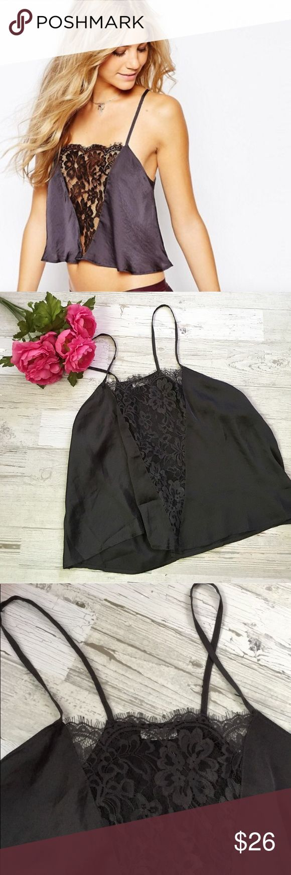 FP Gray Jones Lace Cami NWOT Gorgeous charcoal grey cami tank top by Intimately Free People. Cropped length. Pretty sheer lace panel in front. Split open back. Straps are not adjustable. Really soft and comfy to wear. Great for layering! 1st and last pics from FP website to show fit and color. Bundle with other FP for a discount! Size large but would fit S-L due to flowy fit.  Condition: Brand new, never worn  🚫NO TRADES🚫 ❌No Try Ons❌ Please ask any questions prior to purchasing. All sales…