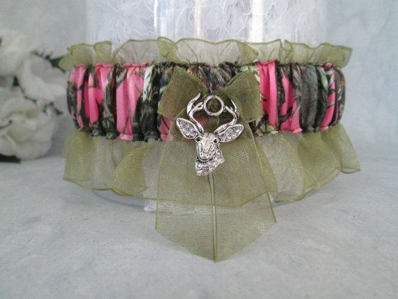 Put the pink in his camo with this fun garter and surprise your hunter on your wedding or special occasion. This is made with pink camouflage satin fabric and mossy green sheer organza. The organza color can be changed to a different color if you like. The beautiful deer head deluxe charm has some bling in it.  PLEASE READ THIS ABOUT SIZING: The sizes you choose from are leg measurements. I will make the adjustment so it (they) will fit comfortably.  PLEASE READ THIS FOR PRODUCTION TIME: I…