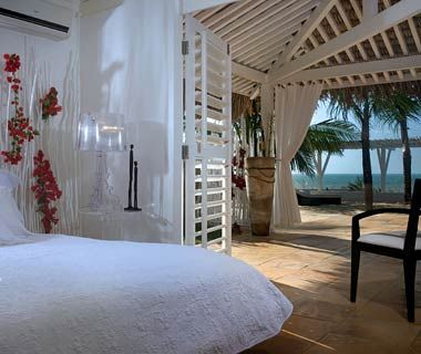 Brazil's Chili Beach Boutique Resort. Features all-white suites and two casitas steps from the surf.