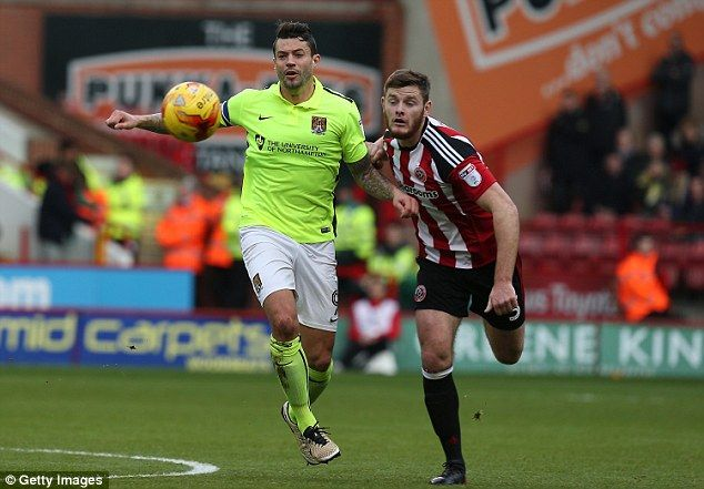 Northampton's Marc Richards challenges for the ball with Sheffield United's Jack O'Connell