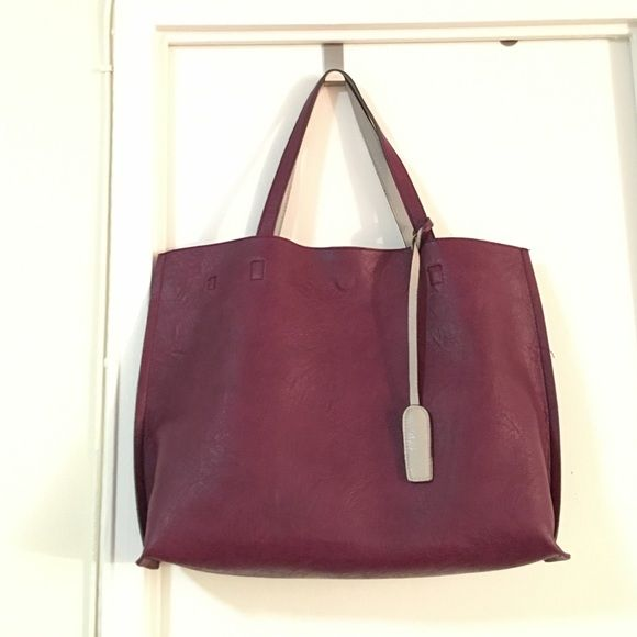Urban Outfitters tote bag Used for several times but in good condition. Burgundy/beige color. Could be used double sides. With a inner pocket. Has a strip Urban Outfitters Bags Totes