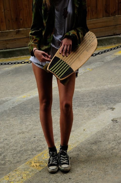 Skater girl style. Long boards, sneakers, bootie shorts