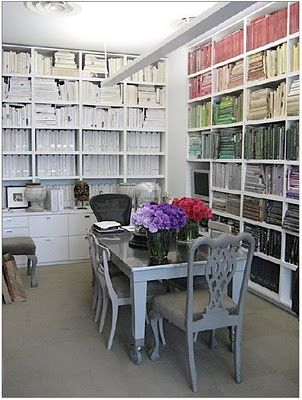 Love the painted gray table on wheels (maybe consider repurposing old IKEA table) for basement office.  Plus, the floor to ceiling bookshelves are always a good idea.
