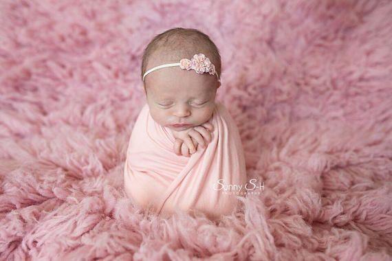 "Beautifully soft newborn stretch jersey wrap, pictured here in ""Blush""."