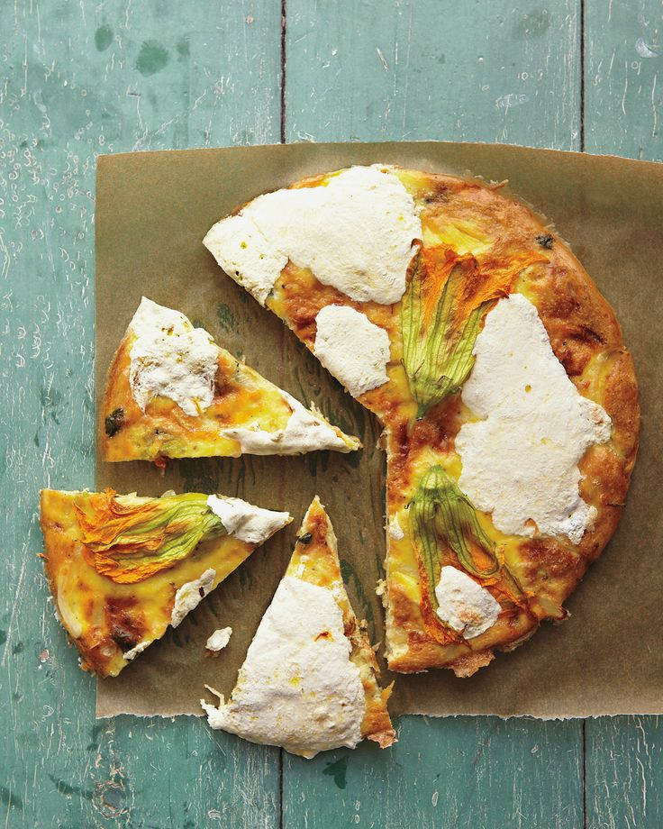 Squash flowers lend a subtle hint of the gourd's flavor and a splash of color to this simple frittata.