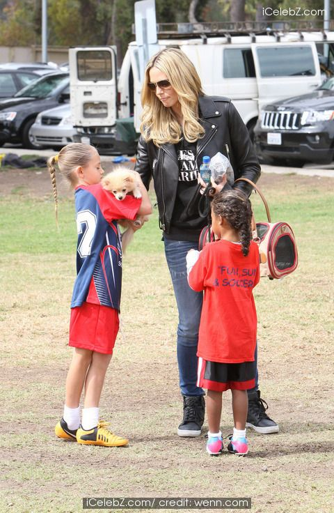 Heidi Klum watches her children playing soccer while looking after their new Pomeranian pet dog called 'Buttercup'http://www.icelebz.com/events/heidi_klum_watches_her_children_playing_soccer_while_looking_after_their_new_pomeranian_pet_dog_called_buttercup_/