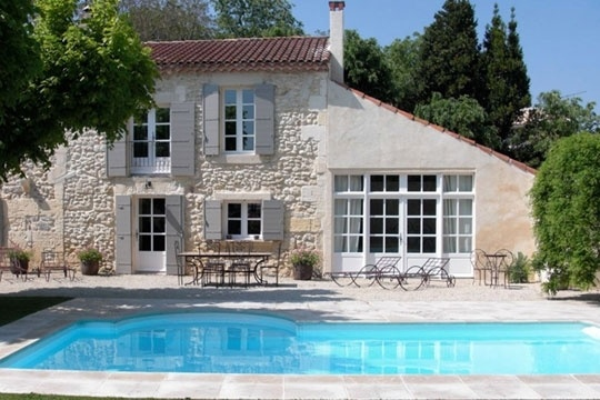 lovely home with pool. Incredible stone work.