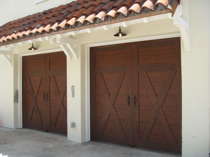 97 best clopay faux wood garage doors images on pinterest for Fake wood garage doors