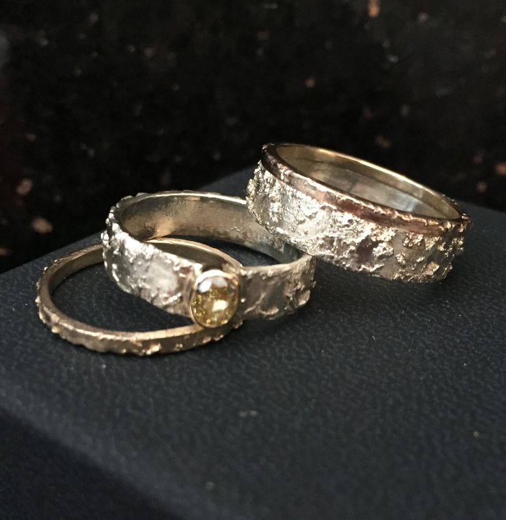 A set of unique handmade weeding rings with a matching yellow diamond enagagement ring