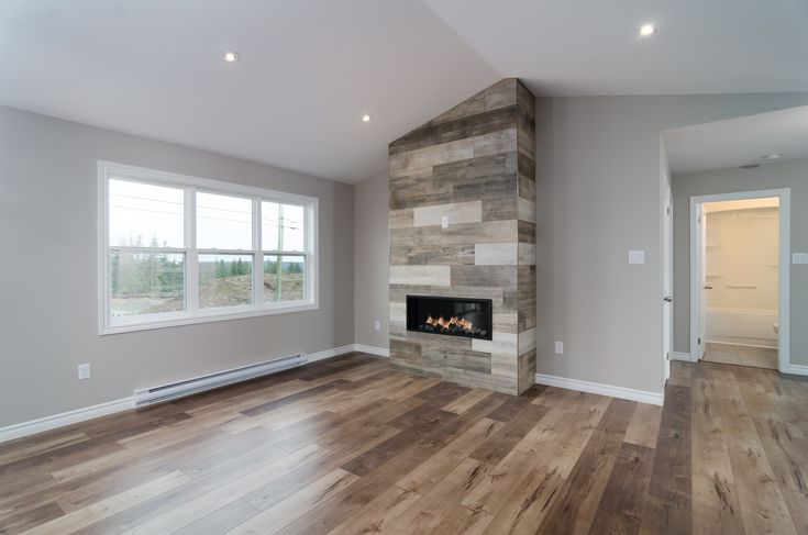 The fireplace and raised ceiling in this custom home in Bristolwood make for a beautiful living area.