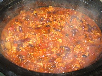"""""""Buffalo Chicken Chili in the Slow Cooker. This was delicious. I didn't cook the chicken and veggies first I just threw everything in the crock pot and shredded the chicken when it was done. This will be a regular winter dinner"""""""