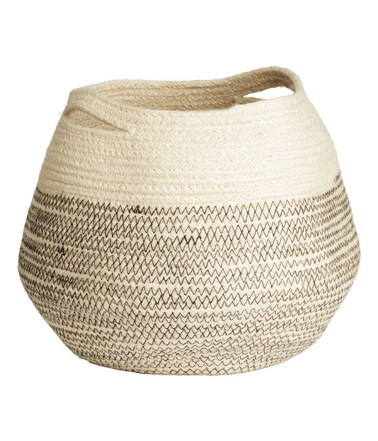 Check this out! Small storage basket in jute with two handles. Diameter approx. 8 1/4 in., height 9 in. - Visit hm.com to see more.