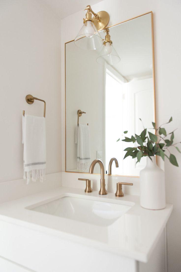 White Marble Countertops Gold Fixtures Gold Rectangular Framed Mirror White Vase Modern Bathroom Renovations White Marble Countertops Upstairs Bathrooms