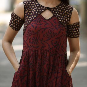 This maroon and blue block printed dress oozes style and takes your style a notch higher. The chic neckline detail,the classic maroon and blue combination and gold highlights makes this dress a perfect stunner. Styling tip: Pair this dress with leather slip ons or boat shoes and go rule the world. This piece has been exclusively created for Rustorange by Delhi based designer Devleena Mazumdar. Size information (Garment Measurements): Small (S): Shoulder 13.5'', Bust 35'...