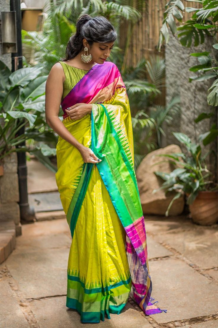 Purple, green and lime yellow - seems like a salad? Unlike a salad, the Pochampally saree is a beautiful combination of these colors. With thick green-teal border on one side and purple-red-gold border on the other, the saree knows how to play with colors safe. Pair her with an hot red blouse or electric blue sleeveless blouse to complete the look. #limeyellow #pochampally #silk # saree #India #blouse #Houseofblouse
