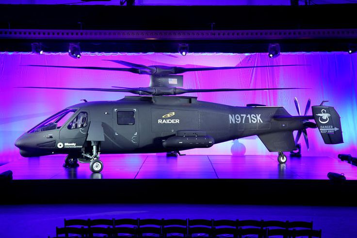 Sikorsky S-97 helicopter shoots for speed with unusual design - The Sikorsky S-97 Raider has an unusual configuration, with two coaxial main rotors on top and a pusher propeller in the rear.