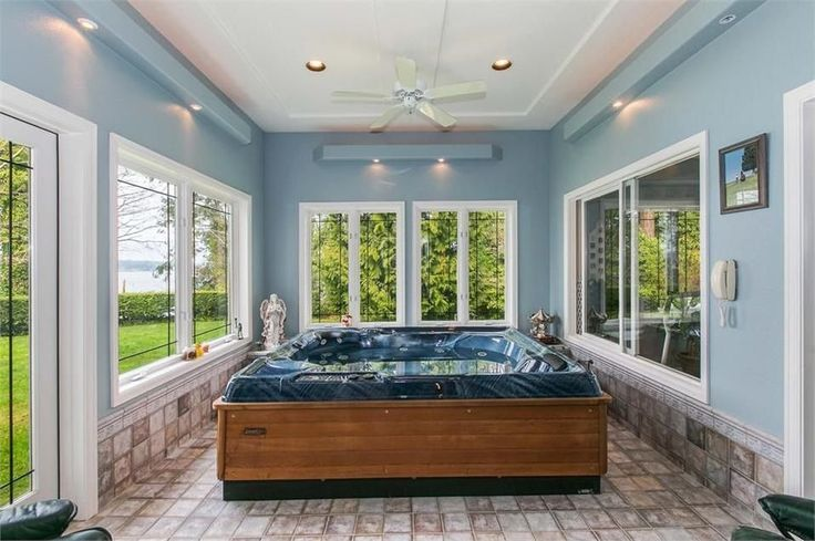 Traditional Hot Tub with exterior stone floors, French doors