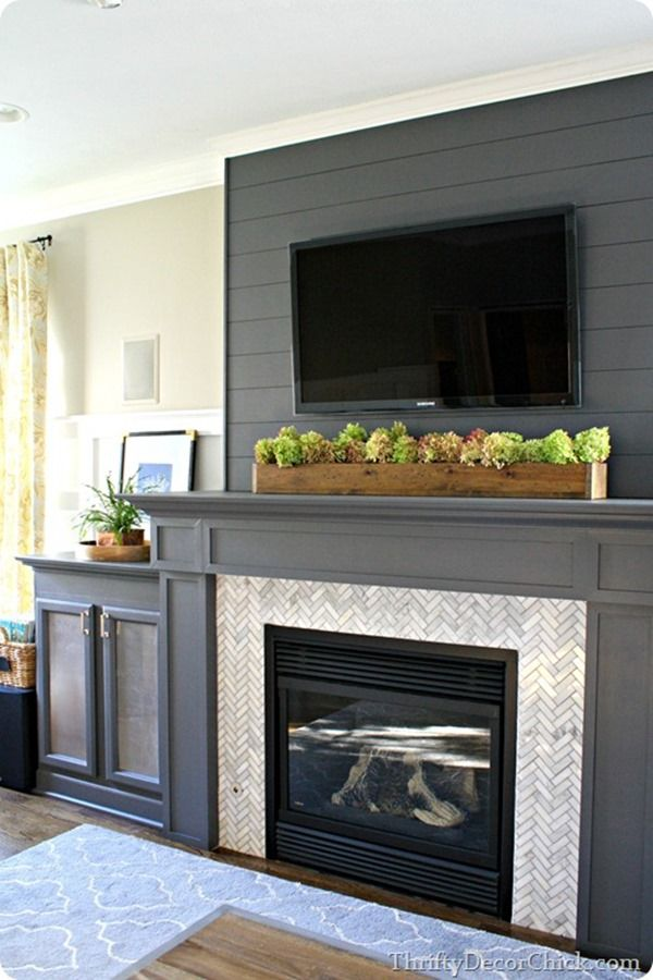 Wall color // succulents under mounted flat screen // glass front cabinet // curtains
