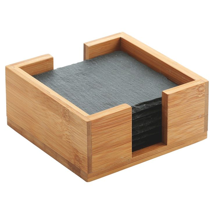 Thirstystone's Slate Coasters in Bamboo Holder Set is a unique and natural way to protect your furniture from messy drips.  The set includes 6 real slate coasters with a deckled edge, each with foam feet that help insulate your tabletops from hot or cold beverages.  The coasters fit perfectly into the holder made of renewable bamboo.  Thirstystone's Slate Coasters in Bamboo Holder Set fits with almost any decor and makes a great gift.