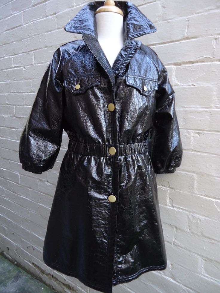 1960's style patent trench coat. Warm lining!! Size 10. $69