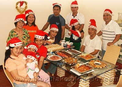 Religion: This is a picture of a Filipino family on christmas. In the Philippines, christmas is all about coming together as a family and getting into the spirit. Many relatives don't make it in for christmas, so they send giant care packages called balikbayan boxes back home. They are filled with everything you could think of, from food, to little things a person would buy on the streets. Christmas has become a huge part of the dominating Roman Catholic religion in the Philippines.