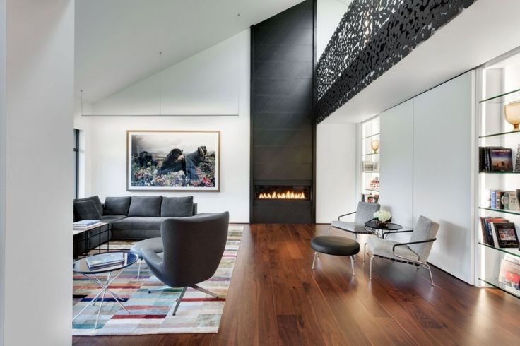 Interior:Glamorous Modern Living Room With Cute Bears Paintings Also Modern Sofas And Chairs With Amazing Fireplace Also Open Shelves Of Iron Lace Modern Mansion Style With Adorable Black Polka Dots Staircase In Montreal Canada Modern Mansion Style with Adorable Black Polka Dots Staircase in Canada